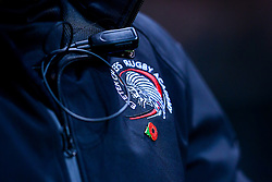Exeter Chiefs Rugby Academy crest on a coat with a Remembrance Poppy - Ryan Hiscott/JMP - 07/11/2018 - SPORT - Sandy Park - Exeter, England - Exeter Chiefs Academy v Royal Navy