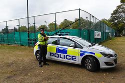 © Licensed to London News Pictures. 22/09/2019. SLOUGH, UK.  A police officer next to cordon tape at Salt Hill Park in Slough, Berkshire, where it is reported a 15 year old boy was fatally stabbed after an altercation with another male.  Emergency services attended the scene at 6.30pm on the evening of 21 September where the boy was pronounced dead.  Investigations are ongoing.  Photo credit: Stephen Chung/LNP