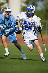 Duke attackman Zach Howell (26) in action against UNC.  The #2 ranked Duke Blue Devils defeated the #12 ranked North Carolina Tar Heels 17-6 in the semi finals of the Men's 2008 Atlantic Coast Conference tournament at the University of Virginia's Klockner Stadium in Charlottesville, VA on April 25, 2008.
