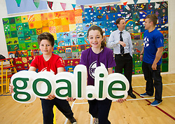 No Repro Fee: 10/04/13.Leinster star Ian Madigan surprises school kids for GOAL..Pictured here are Leinster out-half Ian Madigan and GOAL CEO Barry Andrews wih Conor O'Neill (left), age 12 and Isobel McCann, age 11..The boys and girls of Kill O' The Grange primary school in Deansgrange got a big surprise when Leinster and Ireland rugby star, Ian Madigan paid them a surprise visit to launch a new annual fundraiser for GOAL on 10/04/13. Madigan was helping the aid agency promote their 'GOAL Sports Challenge', a multi-sport event that hopes to boost fitness levels amongst children and teenagers, and also raise money and awareness for some of GOAL's programmes for vulnerable children throughout the developing world..For schools interested in signing up, please email schools@goal.ie for further information about GOAL's work go to www.goal.ie , www.facebook.com/goalireland , @GOALIreland ..Pic: Andres Poveda