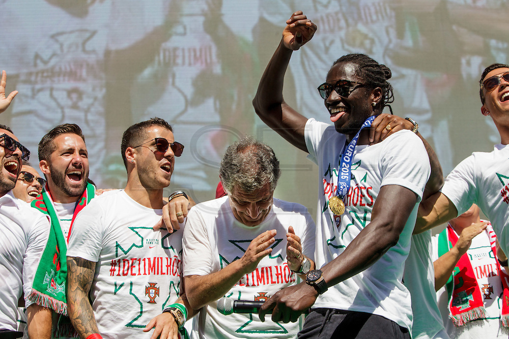 Ederzito and other portuguese team members dancing with the crowd of portuguese supporters at Alameda Dom Afonso Henriques, in Lisbon. Portugal's national squad won the Euro Cup the day before, beating in the final France, the organizing country of the European Football Championship, in a match that ended 1-0 after extra-time.