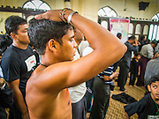 04 NOVEMBER 2014 - YANGON, MYANMAR: Burmese Shia men pray in Mogul Mosque in Yangon during Ashura services. Ashura, commemorates the death of Hussein ibn Ali, the grandson of the Prophet Muhammed, in the 7th century. Hussein ibn Ali is considered by Shia Muslims to be the third imam and the rightful successor of Muhammed. He was killed at the Battle of Karbala in 610 CE on the 10th day of Muharram, the first month of the Islamic calendar. According to Myanmar government statistics, only about 4% of the population is Muslim. Many Muslims have fled Myanmar in recent years because of violence directed against Burmese Muslims by Buddhist nationalists.     PHOTO BY JACK KURTZ
