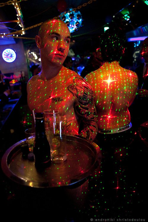 Bar Dragon has two westerners dressed only in their underwear, working as waters