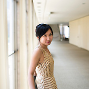 June 3, 2014 - New York, NY : Composer Wang Lu poses for a portrait at Lincoln Center's Avery Fisher hall on Tuesday afternoon. Three works by little-known composers, such as Lu, will be selected for inclusion in the New York Philharmonic's Biennial. CREDIT: Karsten Moran for The New York Times