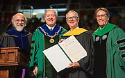 Robert Kirshner receives an honorary degree at graduate commencement ceremonies. Photo by Ben Siegel