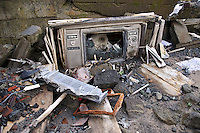 A television in the remains of a building destroyed in a pyroclastic flow, Gunung Merapi, Kinahrejo, Java, Indonesia.