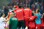 Polish team celebrate after Sebastian Mila's scoring second goal  during the EURO 2016 qualifying match between Poland and Germany on October 11, 2014 at the National stadium in Warsaw, Poland<br /> <br /> Picture also available in RAW (NEF) or TIFF format on special request.<br /> <br /> For editorial use only. Any commercial or promotional use requires permission.<br /> <br /> Mandatory credit:<br /> Photo by © Adam Nurkiewicz / Mediasport