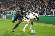 Manchester United Midfielder Paul Pogba battles with Juventus Defender Mattia De Sciglio during the Champions League Group H match between Juventus FC and Manchester United at the Allianz Stadium, Turin, Italy on 7 November 2018.