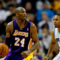 Dec 5, 2012; New Orleans, LA, USA; Los Angeles Lakers shooting guard Kobe Bryant (24) is guarded by New Orleans Hornets shooting guard Xavier Henry (4) during the second half of a game at the New Orleans Arena. The Lakers defeated the Hornets 103-87.  Mandatory Credit: Derick E. Hingle-USA TODAY Sports