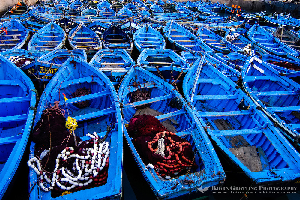 Colourful blue fishing boats. Essaouira is a city on the Moroccan Atlantic coast. Fortress walls originally enclosed the entire city.