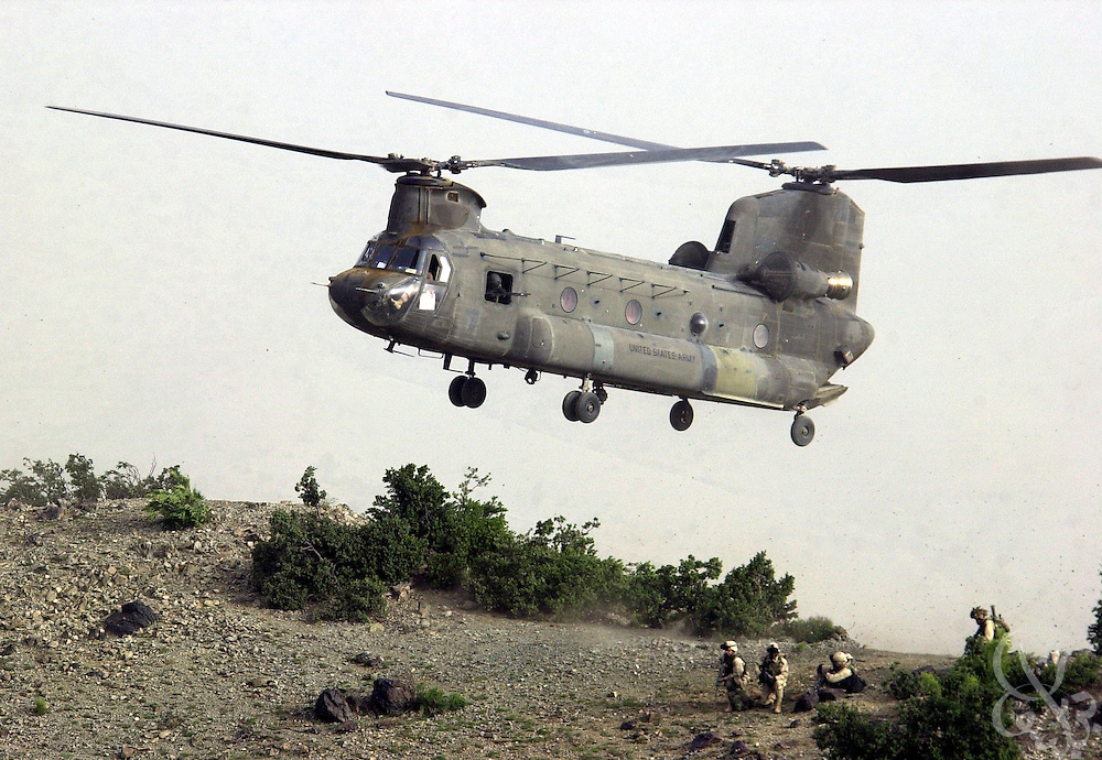 "US Army 101st Airborne 3-187 ""Bravo"" company soldiers are inserted by chinook helicopter 23 July, 2002  on a sensitive site exploitation (SSE) mission near the town of Narizah in Southeastern Afghanistan. The three day mission, intended to deny sanctuary to Al Qaida and Taliban fighters in villages along the Pakistan-Afghanistan border resulted in the recovery of several weapons caches and one Afghan detained for questioning."