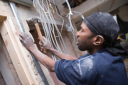 Electrician installing cables,