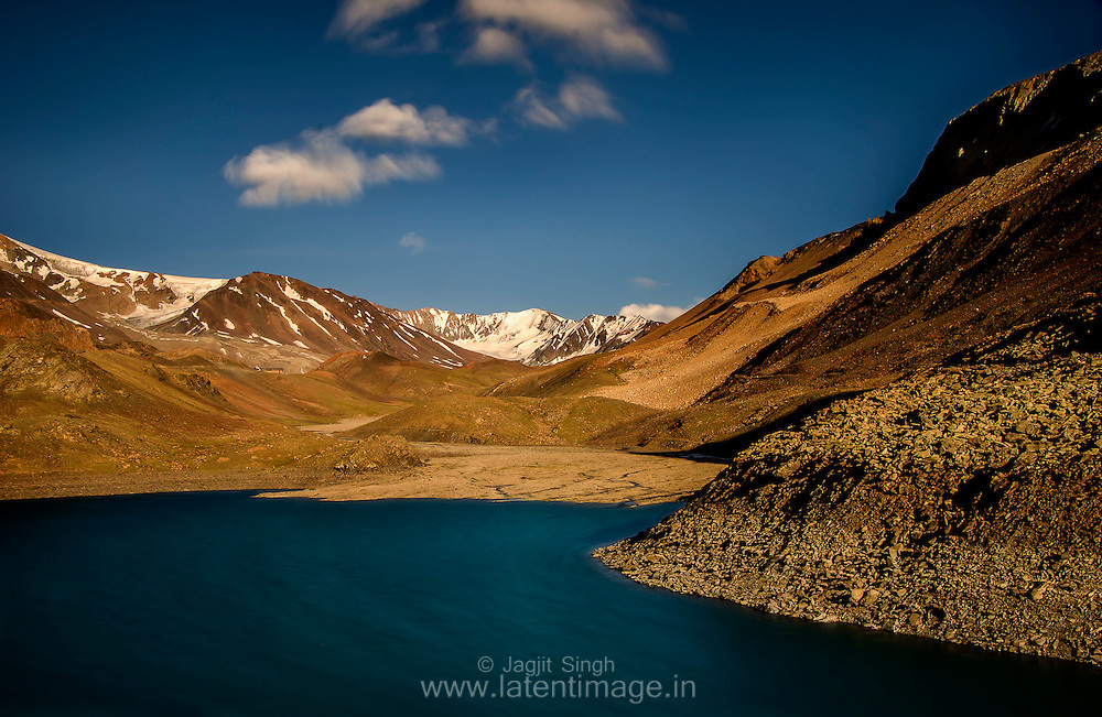 Suraj Tal Lake is located at a height of 4950 m below the summit of the Baralacha pass in the Lahaul region of Lahaul and Spiti. Landscapes by Jagjit Singh