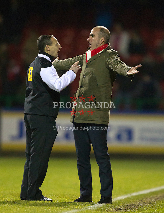 SWINDON, ENGLAND - Friday, December 21, 2012: Swindon Town manager Paolo Di Canio is spoken to by fourth official Adam Tranter whilst in action against Tranmere Rovers during the Football League One match at the County Ground. (Pic by Kieran McManus/Propaganda)