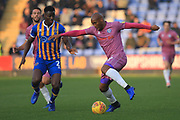 Calvin Andrew looks to cross the ball during the EFL Sky Bet League 1 match between Shrewsbury Town and Rochdale at Greenhous Meadow, Shrewsbury, England on 17 November 2018.