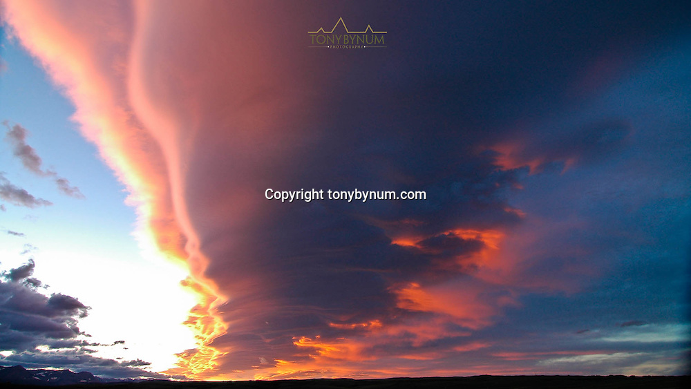 colorful clouds reflecting pink light rocky mountain front