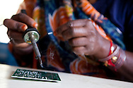 Indian student Meera Bhai, aged 38, from Junak Khera village in Madhya Pradesh, has been studying solar engineering in the Barefoot College in Tilonia village, Ajmer, Rajasthan, India for the last 6 months and will be leaving soon to start her practice in her village of origin. Photo by Suzanne Lee for Panos London