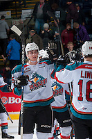 KELOWNA, CANADA - FEBRUARY 10: Cal Foote #25 of the Kelowna Rockets high fives team mates after the win against the Vancouver Giants on February 10, 2017 at Prospera Place in Kelowna, British Columbia, Canada.  (Photo by Marissa Baecker/Shoot the Breeze)  *** Local Caption ***
