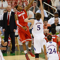 Mar 31, 2012; New Orleans, LA, USA; Ohio State Buckeyes forward Deshaun Thomas (1) attempts a shot as Kansas Jayhawks center Jeff Withey (5) defends during the second half in the semifinals of the 2012 NCAA men's basketball Final Four at the Mercedes-Benz Superdome. Mandatory Credit: Derick E. Hingle-US PRESSWIRE