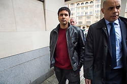 "© Licensed to London News Pictures. 23/03/2016. London, UK.""Flash crash"" Trader NAVINDER SINGH SARAO (centre) arrives at Westminster Magistrates court in London where Judgment in his extradition hearing is due to be given. Sarao, nicknamed the Hound of Hounslow, is accused of contributing to the 2010 flash crash. He has been charged with 22 counts of fraud and market manipulation by the US authorities who want to extradite him. Photo credit: Ben Cawthra/LNP"