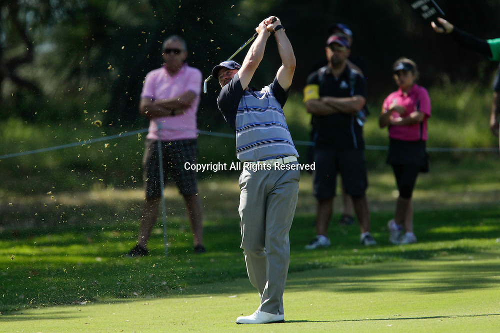 18.10.2013 Perth, Australia. Craig Lee (SCO) plays an approach shot on the 13th fairway during day 2 of the ISPS Handa Perth International Golf Championship from the Lake Karrinyup Country Club.