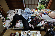 Kawasaki, November 6 2014 - Japanese artist Tatsumi ORIMOTO, 69, at home falling asleep after drinking sake, while taking care of his 97-year-old mother.