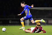 Northampton Town midfielder Shaun McWilliams (17) slides in to tackle Shrewsbury Town midfielder Alex Rodman (23) during the EFL Sky Bet League 1 match between Northampton Town and Shrewsbury Town at Sixfields Stadium, Northampton, England on 20 March 2018. Picture by Dennis Goodwin.