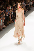 Gauzy gown with wrap details and fringes. By Carlos Miele at the Spring 2013 Mercedes-Benz Fashion Week in New York.