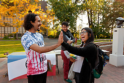 Students who are registered to vote making tie-dye tee shirts on Red Square on Tuesday, Sept. 29, 2015. (Photo/John Froschauer)
