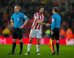 STOKE-ON-TRENT, ENGLAND - Saturday, January 25, 2020: Stoke City's captain Joe Allen shakes hands with an assistant referee after the Football League Championship match between Stoke City FC and Swansea City FC at the Britannia Stadium. Stoke City lost 2-0. (Pic by David Rawcliffe/Propaganda)
