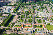 Nederland, Noord-Holland, Amsterdam, 14-06-2012; Overzicht Slotervaart met in het midden (vlnr) Johan Huizingalaan, langs het Sierplein. De laagbouw blokken in het midden vormen Blueband-dorp. Links het water van de Slotervaart..De buurt is onderdeel van de Westelijke Tuinsteden, gerealiseerd op basis van het Algemeen Uitbreidingsplan voor Amsterdam (AUP, 1935). Voorbeeld van het Nieuwe Bouwen, open bebouwing in stroken, langwerpige bouwblokken afgewisseld met groenstroken. .This residential area (Slotervaart) is an example of garden cities of Amsterdam-west. Constructed on the basis of the General Extension Plan for Amsterdam (AUP, 1935). Example of the New Building (het Nieuwe Bouwen), detached in strips, oblong housing blocks alternated with green areas, built in fifties and sixties of the 20th century. .The low-rise is nicknamed Blue band village, after a Unilever margarine brand..luchtfoto (toeslag), aerial photo (additional fee required).foto/photo Siebe Swart