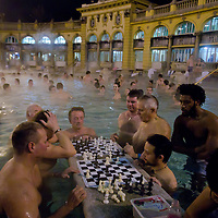 People enjoy the 38 degree celsius thermal pool of Szechenyi bath in Budapest, Hungary on December 11, 2011. ATTILA VOLGYI