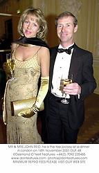 MR & MRS JOHN REID, he is the top jockey at a dinner in London on 14th November 2001.OUF 48