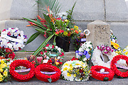 Wreaths of flowers laid at the 2010 ANZAC day parade service at Cenotaph Cairns Queensland