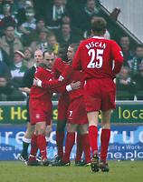 Photo. Andrew Unwin<br /> Yeovil v Liverpool, FA Cup Third Round, Huish Park, Yeovil 04/01/2004.<br /> Liverpool's Emile Heskey (c) celebrates with teammates Danny Murphy (l) and Harry Kewell (r).