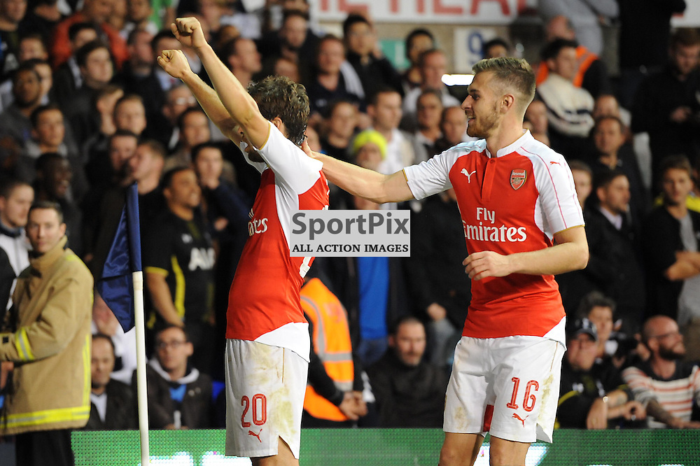Arsenals Matthieu Flamini celebrates with Aaron Ramsey after restoring Arsenals lead during the Capital One Cup third round tie between Tottenham and Arsenal on 23rd September 2015