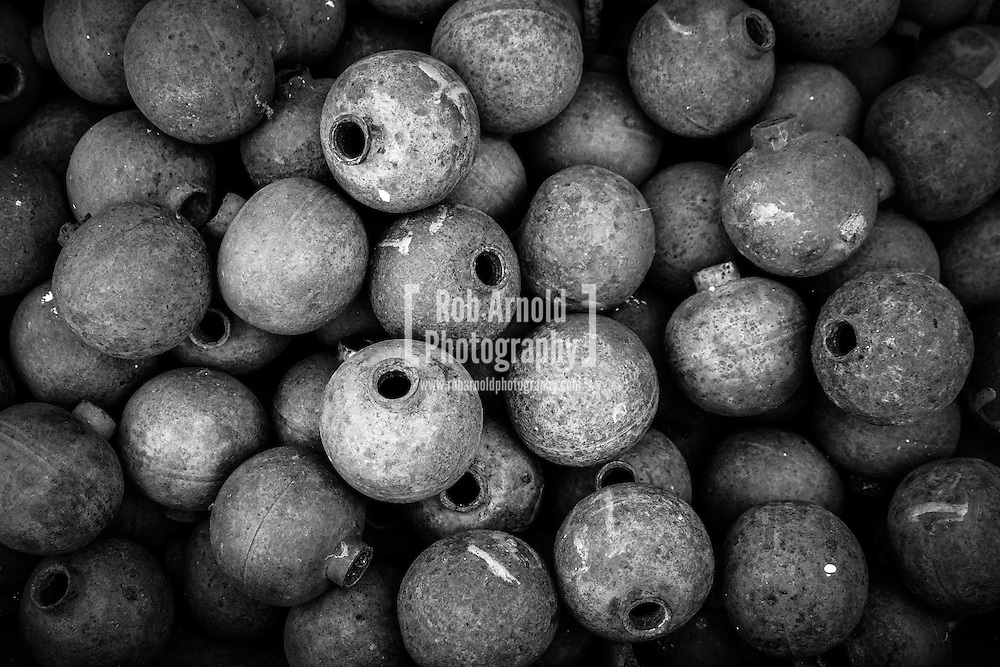 "Cluster bomblets, or ""bombies"", contained within cluster bombs used by the US Air Force in the Vietnam and the Secret War in Laos. Millions of the ""Bombies"" inside still remain unexploded in Laos, causing a serious risk to local lives."