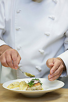Male chef preparing food close-up