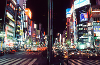 The bustling traffic and neon of Tokyo's Kabukicho district, famous for its bars and nightlife.