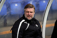 Coventry manager Steven Pressley takes his seat in the dugout. Skybet football league 1match, Tranmere Rovers v Coventry city at Prenton Park in Birkenhead, England on Saturday 22nd Feb 2014.<br /> pic by Chris Stading, Andrew Orchard sports photography.