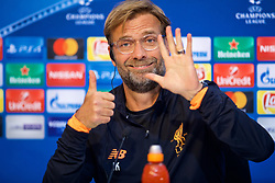 SEVILLE, SPAIN - Monday, November 20, 2017: Liverpool's manager Jürgen Klopp holds up six fingers as he answers a question during a press conference ahead of the UEFA Champions League Group E match between Sevilla FC and Liverpool FC at the Estadio Ramón Sánchez Pizjuán. (Pic by David Rawcliffe/Propaganda)