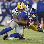 Victor Cruz, New York Giants, is tackled by Morgan Burnett, Green Bay Packers, during the New York Giants Vs Green Bay Packers, NFL American Football match at MetLife Stadium, East Rutherford, New Jersey, USA. 17th November 2013. Photo Tim Clayton