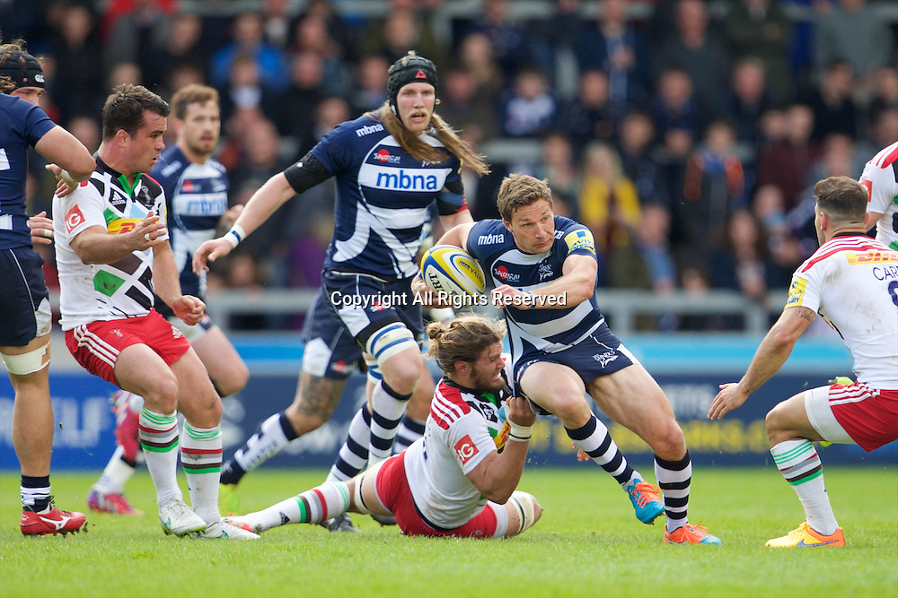 25.04.2015.  Sale, England.  Aviva Premiership Rugby. Sale Sharks versus Harlequins. Sale Sharks scrum-half Chris Cusiter breaks the open field tackle.