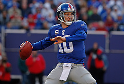 Nov 22, 2009; East Rutherford, NJ, USA; New York Giants quarterback Eli Manning (10) throws a pass during the first half against the Atlanta Falcons at Giants Stadium. The Giants won 34-31.  Mandatory Credit: Ed Mulholland