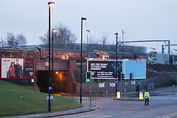 © Licensed to London News Pictures . 23/01/2013 . Manchester , UK . View of the train which is derailed half way across a bridge . A derailed train on a busy stretch of track between Manchester and Salford today (23rd January 2013) . The accident has closed many major commuter routes adjacent to the track including the city's A57M Regent Road . Photo credit : Joel Goodman/LNP