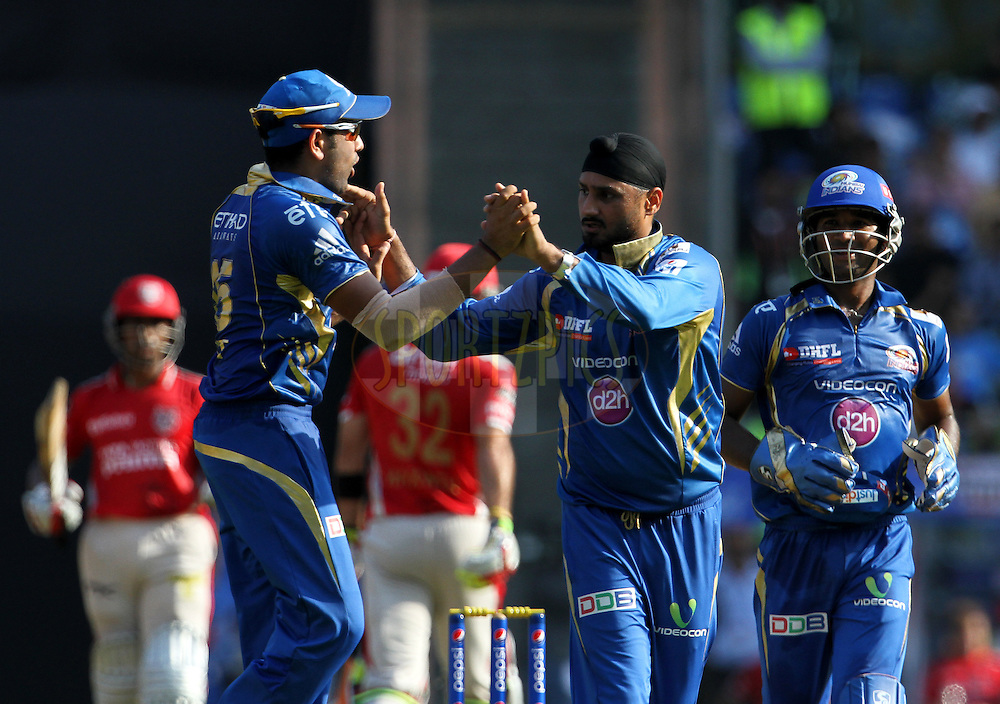 Harbhajan Singh of the Mumbai Indians celebrates after getting the wicket of Glenn Maxwell of the Kings X1 Punjab during match 22 of the Pepsi Indian Premier League Season 2014 between the Mumbai Indians and the Kings XI Punjab held at the Wankhede Cricket Stadium, Mumbai, India on the 3rd May  2014<br /> <br /> Photo by Vipin Pawar / IPL / SPORTZPICS<br /> <br /> <br /> <br /> Image use subject to terms and conditions which can be found here:  http://sportzpics.photoshelter.com/gallery/Pepsi-IPL-Image-terms-and-conditions/G00004VW1IVJ.gB0/C0000TScjhBM6ikg