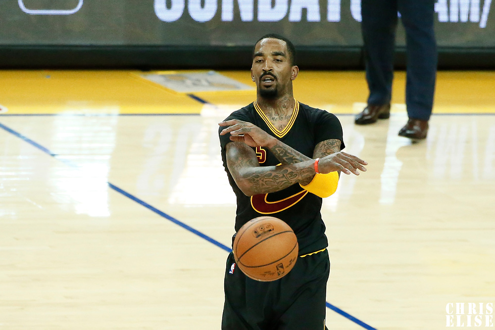 12 June 2017: Cleveland Cavaliers guard JR Smith (5) passes the ball during the Golden State Warriors 129-120 victory over the Cleveland Cavaliers, in game 5 of the 2017 NBA Finals, at the Oracle Arena, Oakland, California, USA.