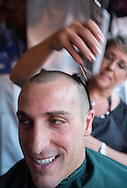 A man has his head-shaving during the annual St. Baldrick's Day head-shaving fundraiser on Thursday, March 14, 2013, in Arcadia, California. More than100 women and men shaved their heads to raises money for child cancer research. The event, ``St. Baldrick's Day,'' is part of a global effort and the world's biggest volunteer-driven fundraising program for childhood cancer. (Photo by Ringo Chiu/PHOTOFORMULA.com).