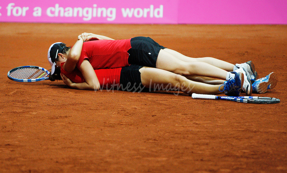 Belgium's Yanina Wickmayer and Kirsten Flipkens (top) celebrate their victory over Canada during their Fed Cup World Group II playoff tennis double match in Hasselt, April 26, 2009. REUTERS/Thierry Roge   (BELGIUM SPORT TENNIS)