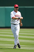 ANAHEIM, CA - APRIL 26:  First baseman Casey Kotchman #35 of the Los Angeles Angels of Anaheim stretches during pregame warmups against the Tampa Bay Devil Rays at Angel Stadium in Anaheim, California on April 26, 2007. The Angels defeated the Devil Rays 11-3. ©Paul Anthony Spinelli *** Local Caption *** Casey Kotchman